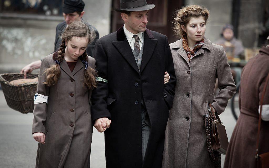 Julia Lewenfisz-Gorka, Wojciech Zielinski, and Marta Ormaniec portraying Ora, Abraham and Luba Lewin in a Ghetto street scene. Courtesy of Anna Wloch