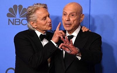 Michael Douglas, left, and Alan Arkin have some fun after winning big at the 76th annual Golden Globe Awards in Beverly Hills, Calif., Jan. 6, 2019. (Mark Ralston/AFP/Getty Images) Via JTA
