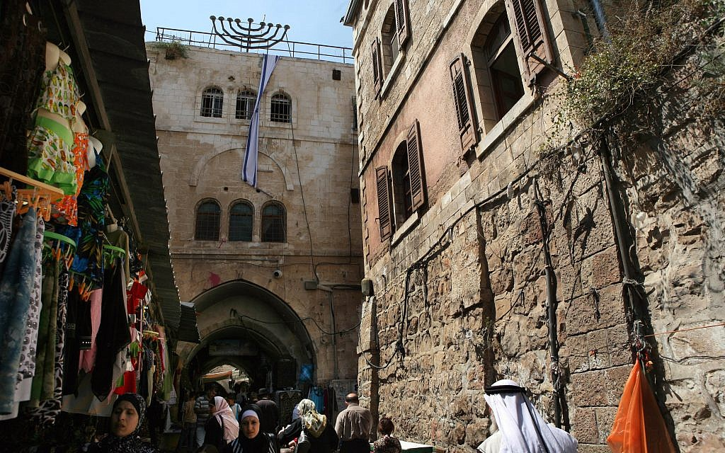 Illustrative image of a property in the Muslim Quarter of Jerusalem's Old City owned by Ateret Kohanim. Here people walk past the Wittenberg House, which was previously owned by former Israeli prime minister Ariel Sharon and used as a place of cultural gatherings at the end of the 1800s. Getty Images
