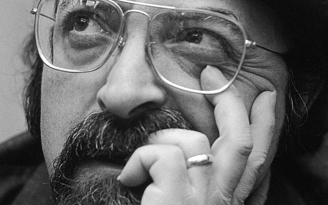Closeup of American author Chaim Potok (1929 - 2002) leaning his face on his hand in a beret, 1970s. Getty Images