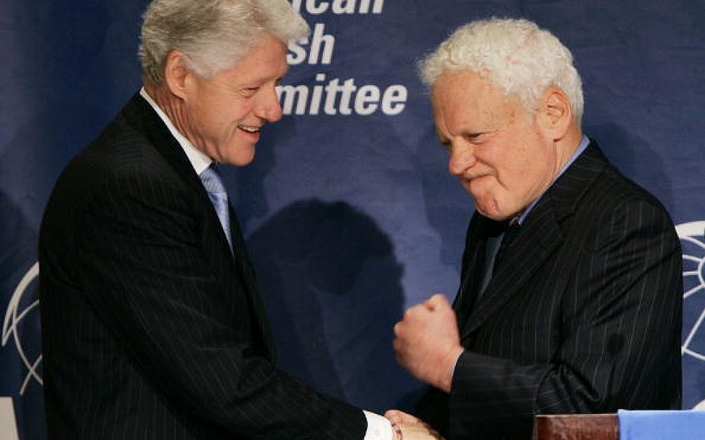 Alfred Moses (R) greets Former U.S. President Bill Clinton at an American Jewish Committee annual meeting in Washington DC. in 2005.  Getty Images