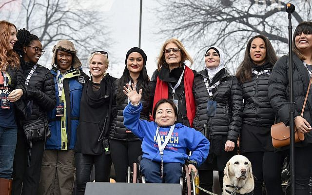 (L-R back row) Bob Bland, Nantasha Williams, Jamiah Adams, Ginny Suss, Carmen Perez, Gloria Steinem, Linda Sarsour, Janaye Ingram and (front row) Mia Ives-Rublee. Getty Images