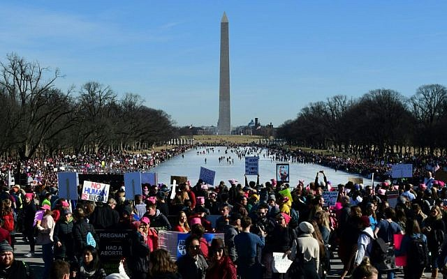 Thousands take part in the Women's March on Washington on the National Mall January 20, 2018 in Washington, DC. Getty Images