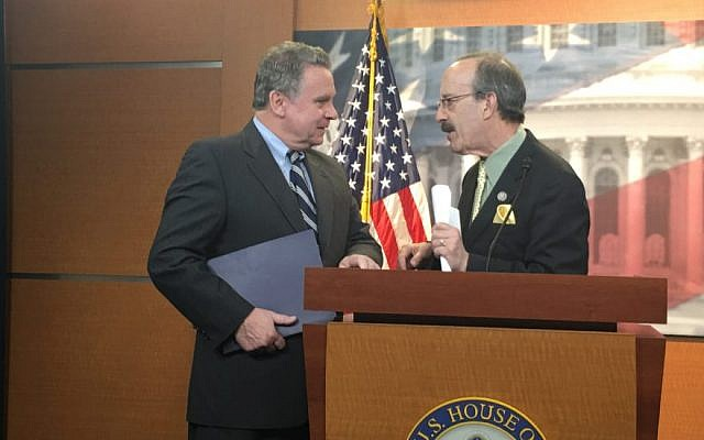 Rep. Chris Smith, R-N.J). left, and Rep. Eliot Engel, D-N.Y., confer in the Capitol in Washington D.C. after releasing a letter to President Trump demanding more action to combat anti-Semitism on March 2 2017. JTA