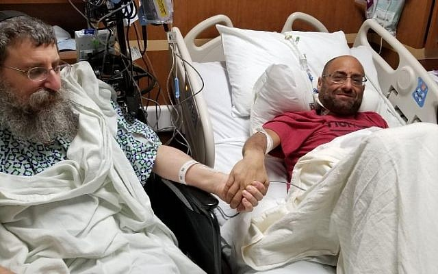 Altruistic liver donor Rabbi Ephraim Simon, left, and recipient Adam Levitz meet prior to surgery at the Cleveland Clinic. JTA