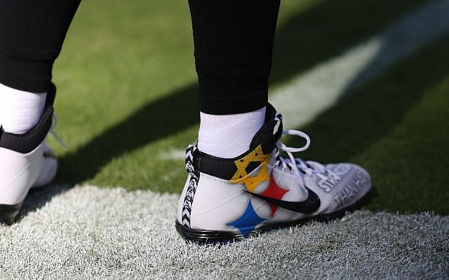 Steelers quarterback Ben Roethlisberger wears cleats Sunday to honor the victims of the Pittsburgh synagogue shooting during the Nov. 4, 2018 game against the Baltimore Ravens. (Will Newton/Getty Images) Via JTA