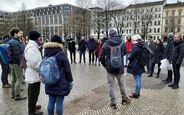 Volunteers gathering in Berlin's Kreuzberg neighborhood to clean stolpersteine on international Holocaust Remembrance Day, January 27, 2019. (Yaakov Schwartz/Times of Israel)