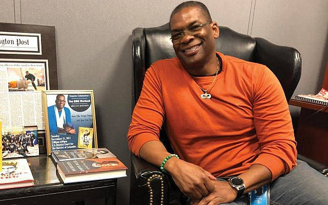 """Bryant Johnson, Ruth Bader Ginsburg's personal trainer, in his office in the U.S. District Court in Washington. """"I help her with her quality of life,"""" he says of Justice Ginsburg. Ron Kampeas"""