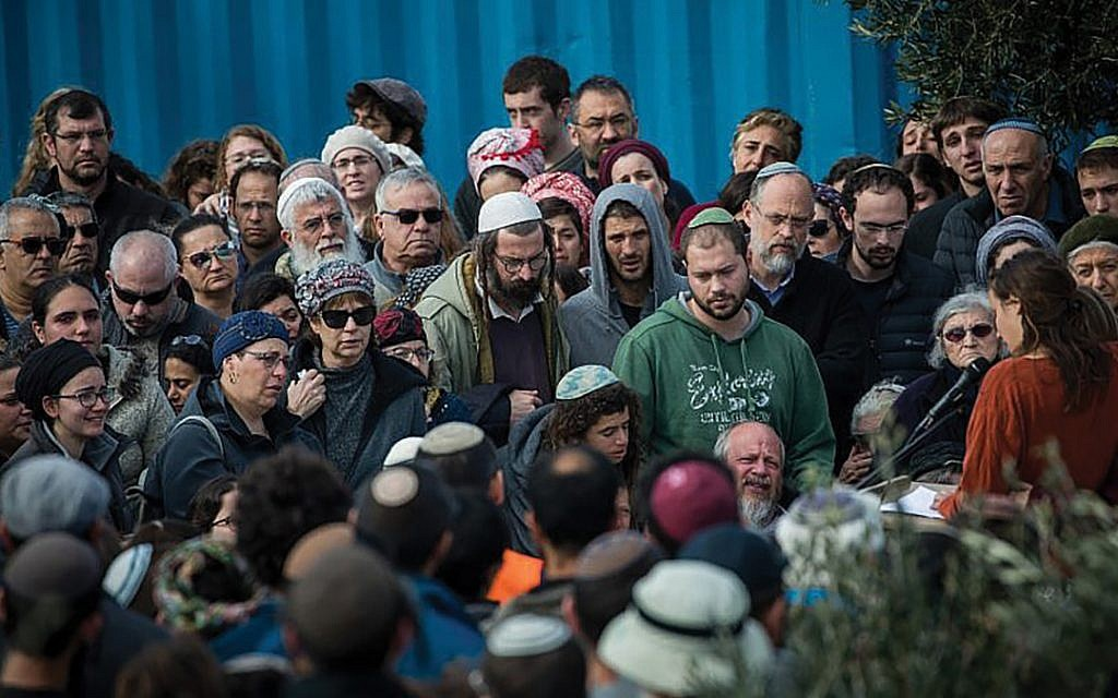 The scene at Ori Ansbacher's funeral earlier this month. In Tekoa this week, thousands of Israelis hiked and played music, by way of vigil, to honor two of the 19-year-old's passions. Yonathan Sindel/Flash90 via JNS.org