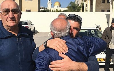 A well-wisher hugs the father of slain Israel Arab woman before her funeral in Baqa al-Gharbiyye. Nathan Jeffay/JW