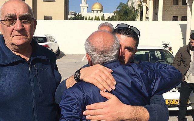 A well-wisher hugs the father of slain Israel Arab woman before her funeral in Baqa al-Gharbiyye. Nathan Jeffay/JW