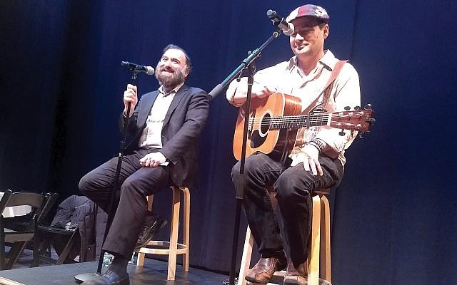 Noah Solomon, right, and Rabbi Naftali Citron sing chasidic melodies at the closing of a recent conference on Kabbalah at the Marlene Meyerson JCC. Ben Sales
