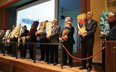 A procession of Torahs at Temple Emanu-El. Photos courtesy of Temple Emanu-El