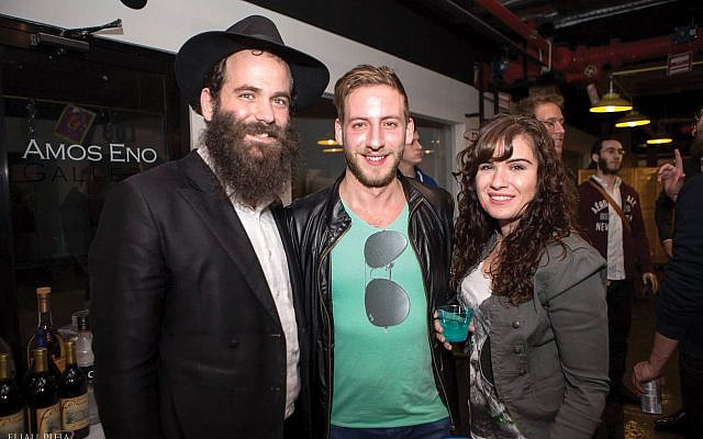 Rabbi Menachem Heller, left, with Chabad of Bushwick members at a Chanukah party in 2015.  Eliau Piha/Chabad of Bushwick