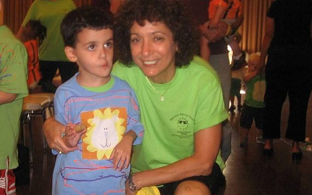 The author's son with his beloved teacher. Courtesy of Jodi Singer