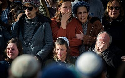 Friends and family members attend the funeral of 19 year old Ori Ansbacher, in the West Bank settlement of Tekoa, Feb. 8, 2019. (Yonatan Sindel/Flash90/via JTA)