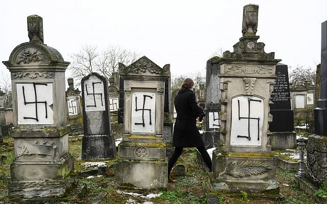 A picture taken on December 17, 2018 in Herrlisheim shows jewish headstones tagged with swastika symbol at a Jewish cemetery, eastern France. SEBASTIEN BOZON/AFP/Getty Images