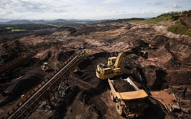 Firefighters use heavy machinery during the search of victims, 20 days after the rupture of a tailings dam of mining company Vale in Corrego do Feijao, near Brumadinho, in the Brazilian state of Minas Gerais. DOUGLAS MAGNO/AFP/Getty Images