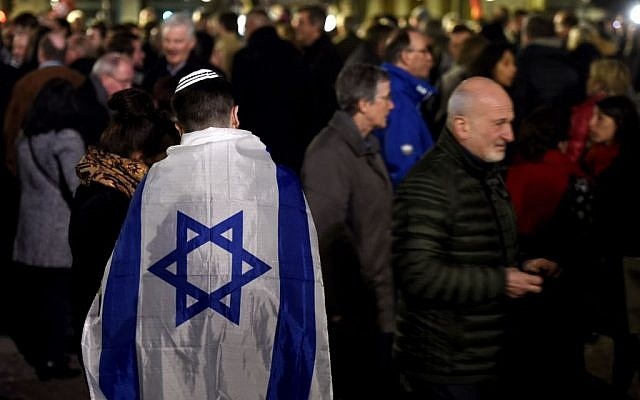 A man wears an Israeli flag as he takes part in a rally against antisemitism, in Lille, on February 19, 2019, on a day of nationwide actions against a rise in anti-Semitic attacks in France. Getty Images