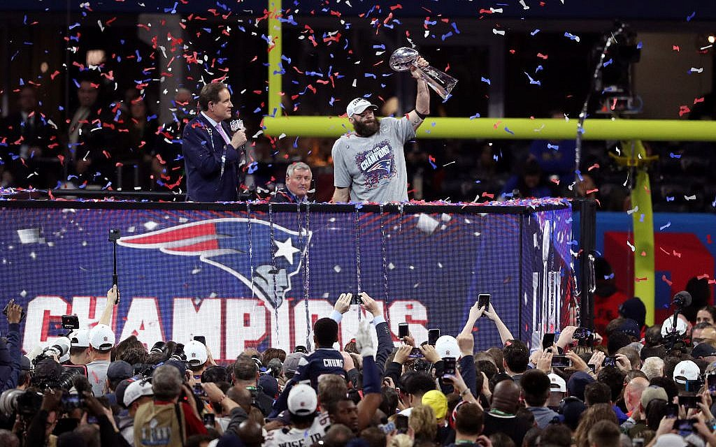 Julian Edelman #11 of the New England Patriots celebrates his teams 13-3 win over the Los Angeles Rams with the Vince Lombardi Trophyduring Super Bowl LIII at Mercedes-Benz Stadium on February 03, 2019 in Atlanta, Georgia. Photo by Patrick Smith/Getty Images