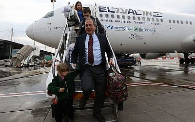 Rabbi Yechiel Eckstein exiting the first aliyah flight organized by the the International Fellowship of Christians and Jews, December 2014. (Courtesy of the International Fellowship of Christians and Jews/via Times of Israel)