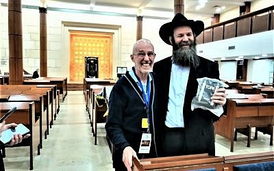 The author with a Chabad rabbi in Marina Roscha Synagogue. Courtesy