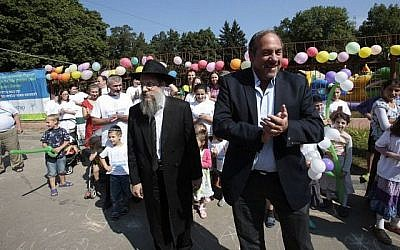 Rabbi Shlomo Gopin (left) and Rabbi Yechiel Eckstein at the Ukrainian 'displaced persons' camp for Jews. (Olivia Pitoussi/via Times of Israel)