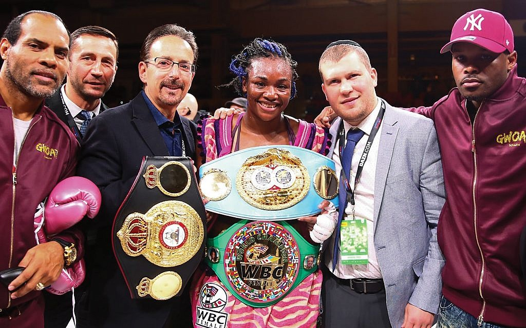 Dmitriy Salita, second from right, congratulates Claressa Shields, a top fighter in his stable, after a recent victory. TERRELL GROGGINS
