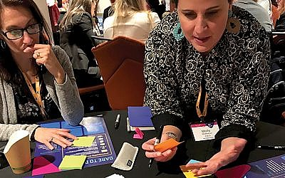 Brainstorming: Molly McMahon of The Teachers Guild, right, led a Design Thinking workshop on financial stability, challenging participants to come up with out-of-the-box ideas. Gary Rosenblatt/JW