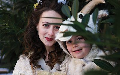"""Holly Flack as Dinorah and Carina Golden as her pet goat Bella in """"Dinorah.""""  Robin Porter Van Sise / Wikimedia Common"""