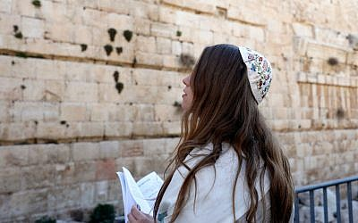 "A member of the liberal Jewish religious movement ""Women of the Wall"" (WOW), wearing a kippa and ""Tallit"" traditional Jewish prayer shawls for men, prays during an event marking the organization's 30th anniversary and the start of the Jewish month (Rosh Chodesh) of Adar Bet, at the egalitarian prayer section (also known as  Ezrat Israel) on the southern side of the Western Wall March 8, 2019. Getty Images"