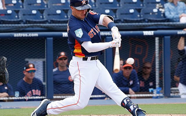 Alex Bregman #2 of the Houston Astros hits the ball against the Miami Marlins during a spring training game at The Fitteam Ballpark of the Palm Beaches on March 14, 2019 in West Palm Beach, Florida. Getty Images