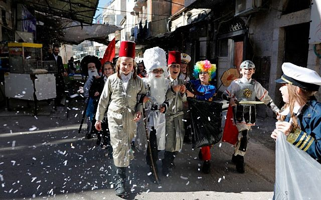 Celebrating the lead up to Purim in the Mea Shearim neighborhood of Jerusalem on March 19, 2019. Getty Images