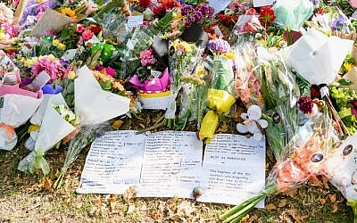 Flowers and condolences are seen in front of Al Noor mosque on March 20, 2019 in Christchurch, New Zealand. 50 people were killed, and dozens are still injured in hospital after a gunman opened fire on two Christchurch mosques on Friday, 15 March, 2019. The gunman was an active user on 8Chan. Getty Images