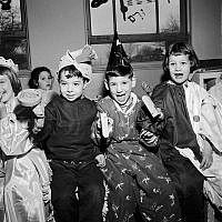 Children celebrating Purim circa 1950. Getty Images