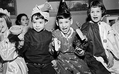 Children celebrating Purim circa 1950. Getty Images