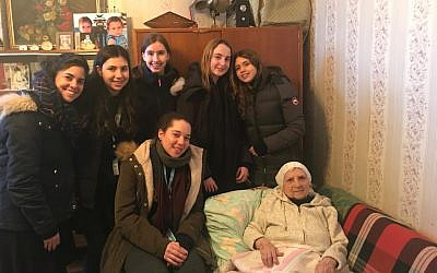 Ramaz students visit the home of an elderly  Moldovan woman. Photo credit: Ms. Elisheva Massel
