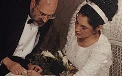 Daphne signs a halakhic prenup with mesader kedushin, Rabbi Altshul. Courtesy of Daphne Lazar Price.
