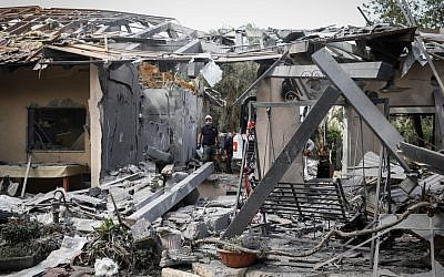 Israeli security forces inspect the scene of a house that was hit by a rocket fired from the Gaza Strip in Moshav Mishmeret in central Israel, on March 25, 2019. JTA
