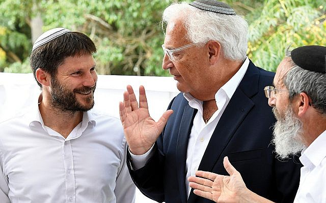 Smotrich, left, with U.S. Ambassador David Friedman during a 2017 visit to a Sderot yeshiva. Wikimedia Commons