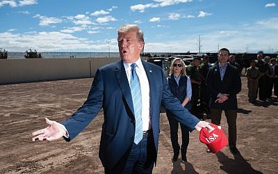 President Donald Trump tours the border wall between the United States and Mexico. Getty Images)