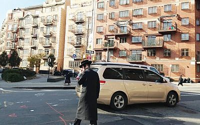 A charedi Orthodox man crosses the street in Williamsburg, Brooklyn. Gil Shefler
