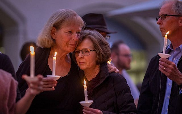 POWAY, CA - APRIL 27: People attend a prayer and candlelight vigil at Rancho Bernardo Community Presbyterian Church on April 27, 2019 in Poway, California. Getty Images