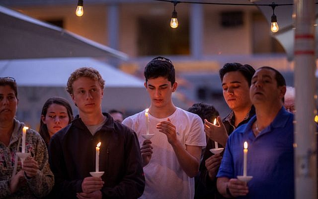 People attend a prayer and candlelight vigil at Rancho Bernardo Community Presbyterian Church on April 27, 2019 in Poway, California. A gunman opened fire at the nearby Congregation Chabad synagogue on the last day of Passover leaving one person dead and three others injured. Getty Images
