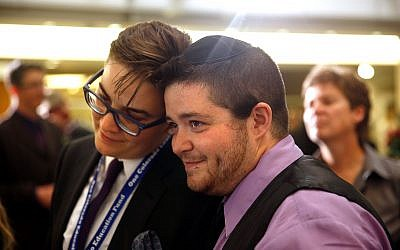 Laurel Javors, left, and Rafi Daugherty listen as another couple is issued a civil union license at a midnight ceremony in the Denver Office of the Clerk and Recorder, May 1, 2013. (Marc Piscotty/Getty Images/via JTA)