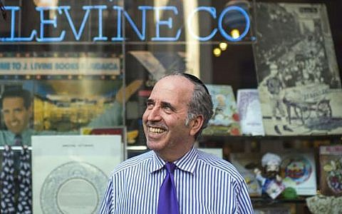 Daniel Levine outside of J. Levine Books on West 30th Street, which has drawn foot traffic from rabbis and professors, priests and pastors for more than 30 years. Steve Lipman