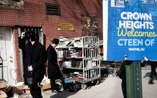 Orthodox Jewish men look through books in the neighborhood of Crown Heights in Brooklyn, New York, Feb. 25, 2019. Spencer Platt/Getty Images