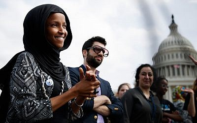 Rep. Ilhan Omar, along with her spokesman, Jeremy Slevin, attend a youth protest at the Capitol trying to force action on climate change, March 15, 2019. (Tom Brenner/Getty Images)