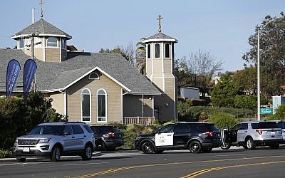 Police vehicles gather around the synagogue where a shooting took place in Poway, Calif., April 27, 2019. A suspect has been identified as 19-year-old John Earnest, authorities said. (Xinhua/ via Getty Images)