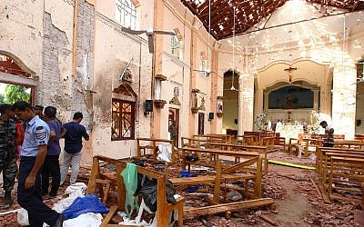 Sri Lankan officials inspect St. Sebastian's Church in Negombo, north of Colombo, after multiple explosions targeting churches and hotels across Sri Lanka took place on April 21, 2019. (Getty Images/via JTA)